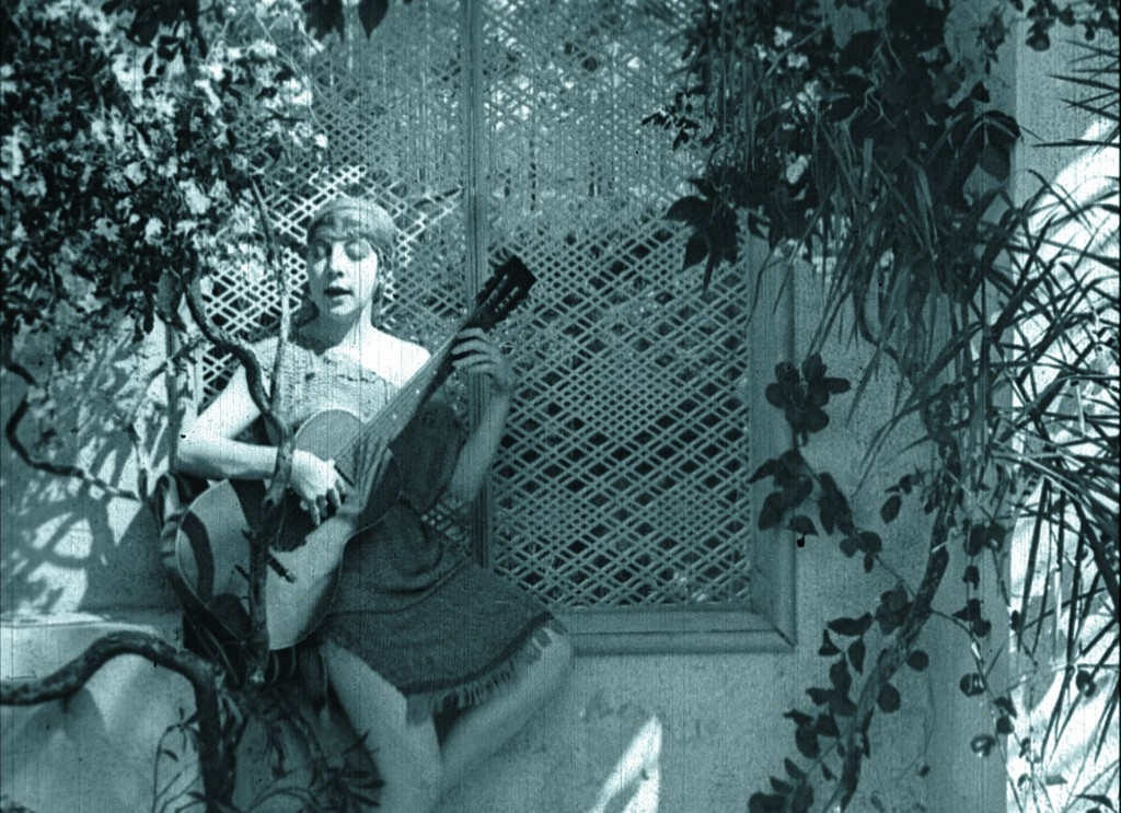 Rose Arnold (Jane Gail) held captive, in the silent film Bitter Fruit (1920)