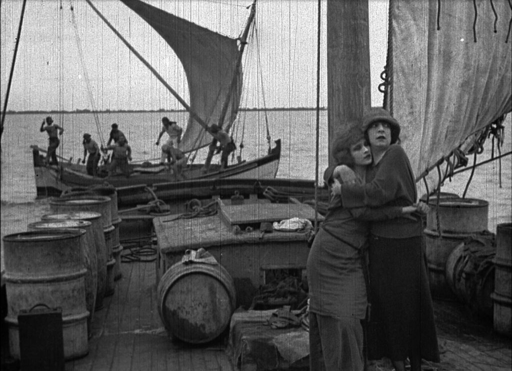 Rose Arnold (Jane Gail) and her sister Polly (Ruth Pecheur) attacked by pirates, in Bitter Fruit (1920)