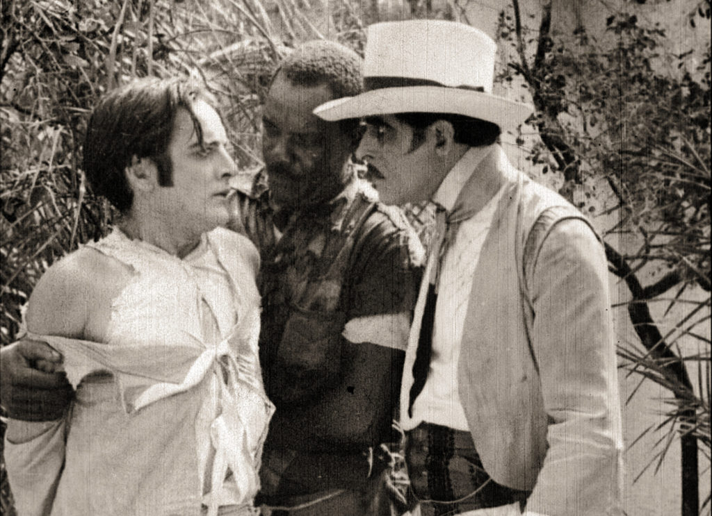 Plantation owner Carlos is confronted by his evil uncle, Gaspard, in the silent film Bitter Fruit (1920)