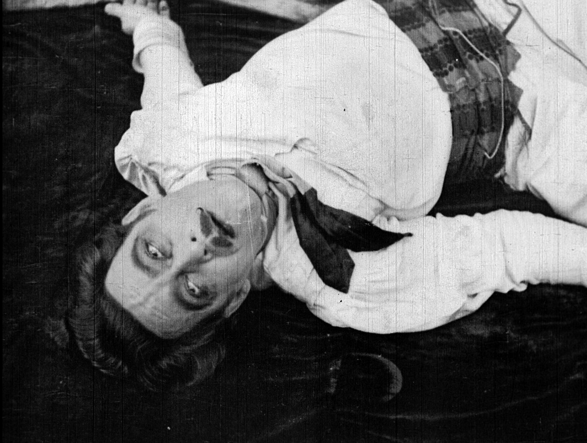 The villain lays dead, Gaspard (John Charles), in the silent film Bitter Fruit (1920)