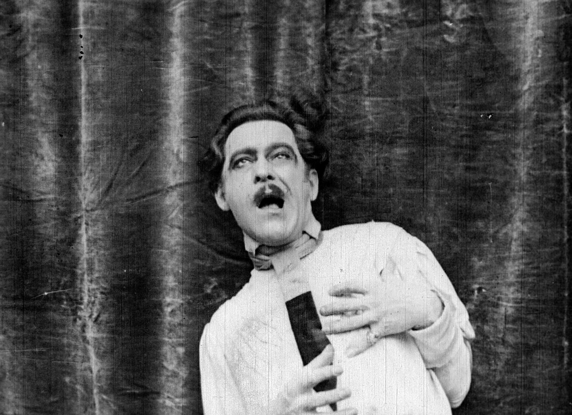 Gaspard (John Charles) dies in the silent film Bitter Fruit (1920)